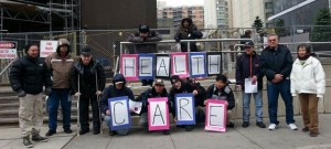Injured workers gather outside the Ministry of Labour in Toronto on Dec. 3, 2014, to demand changes to how the WSIB provides healthcare.