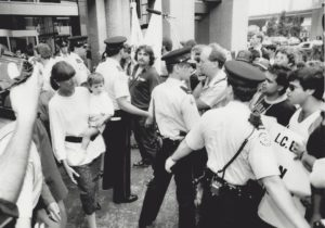 """""""You're a goddam phoney!"""" shouts a striking letter carrier at Mulroney who used his family to cross a picket line in Toronto after saying he would not. Photo: Bernard Weil, Toronto Star"""