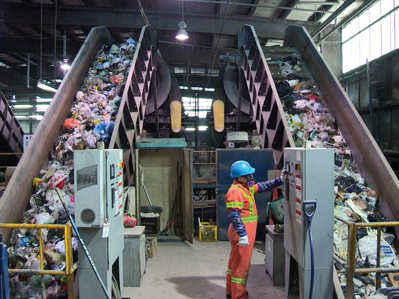 A workers at a garbage processing plant
