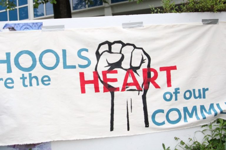 Banner that reads Schools and the heart of our community