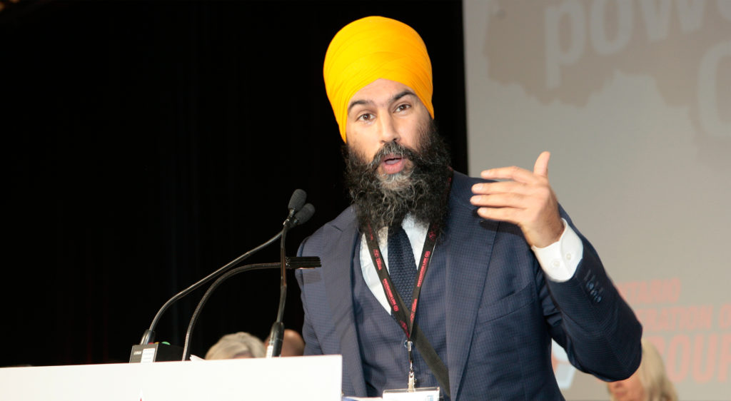 Jagmeet Singh speaking into a microphone